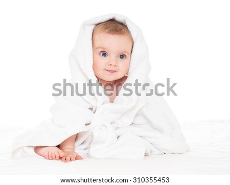 Beautiful happy baby  in a towel after bath. One, isolated on white.