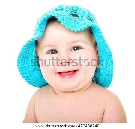 Beautiful happy baby in blue hat. . One,isolated on white.