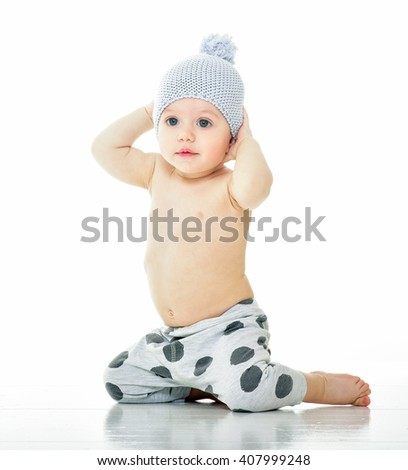 Beautiful happy baby. One, isolated on white. cheerful baby in the hat.
