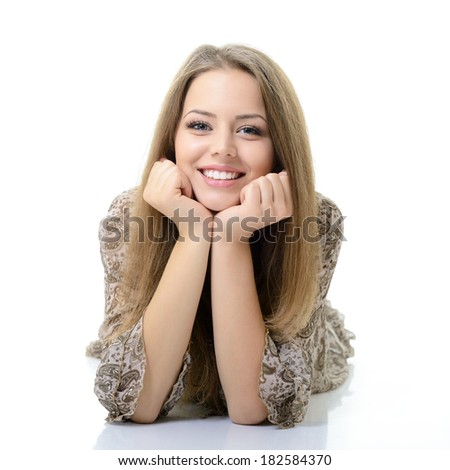 Beautiful happy blond girl lying and looking at camera. Isolated on white background - stock photo