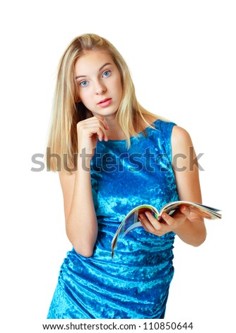 beautiful happy blond teenage girl looking on camera and holding magazine on white background
