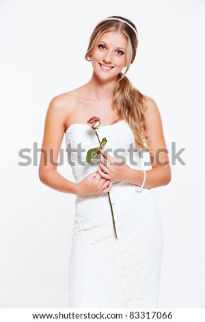 beautiful happy bride with flower - stock photo