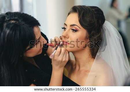 Beautiful happy bride with wedding hairstyle bright makeup in bridal day in love. Happy sexy girl waiting for groom. Romantic lady beauty model bride in bridal day have final preparation for wedding