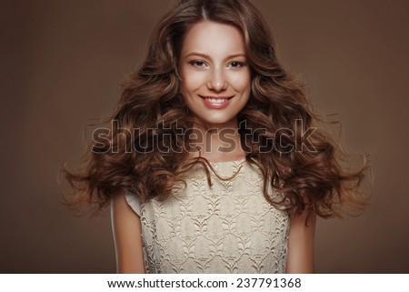 Beautiful Happy Brunette with Long Curly Hairs - stock photo