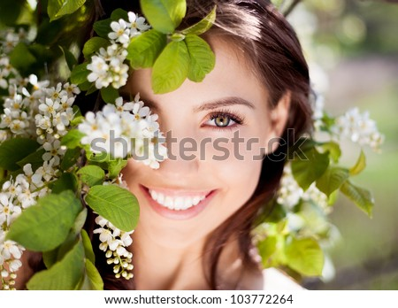 beautiful happy brunette woman in the park on a warm summer day - stock photo
