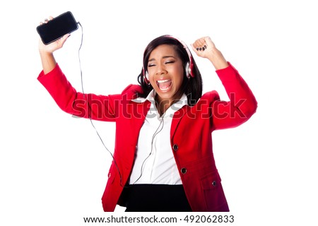 Beautiful happy business woman jamming singing listening to music on wireless mobile phone, on white.