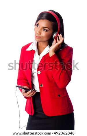 Beautiful happy business woman listening to podcast or music on wireless mobile phone, on white.