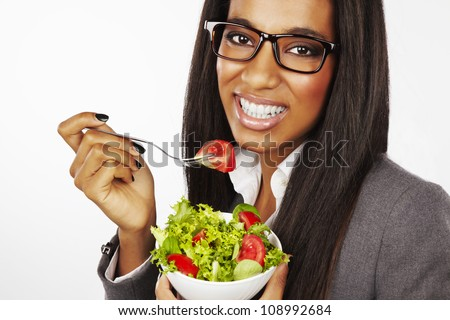 beautiful happy businesswoman eating salad isolated - stock photo