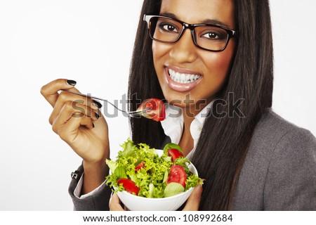 beautiful happy businesswoman eating salad isolated - stock photo
