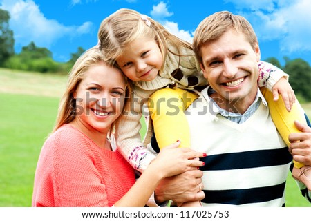 Beautiful happy caucasian family of three. Father, mother and daughter