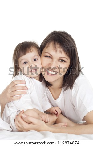 beautiful happy Caucasian mother with her daughter lying on the bed