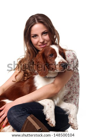 Beautiful happy caucasian woman posing with dog - stock photo