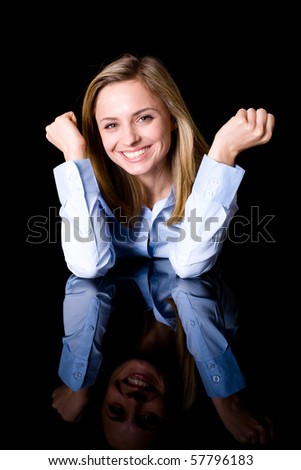 beautiful happy, cheerful woman in plain blue shirt, studio shoot isolated on black background