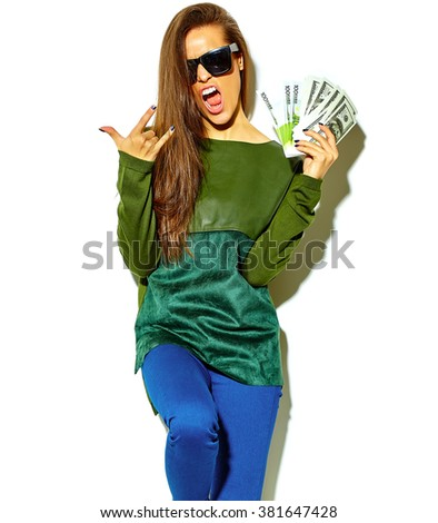 beautiful happy cute smiling brunette woman girl in casual green hipster summer clothes with no makeup isolated on white in sunglasses holding dollar and euro banknotes, showing rock and roll sign - stock photo