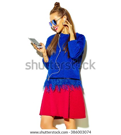 beautiful happy cute smiling sexy brunette woman girl in casual colorful summer clothes with red lips isolated on white listening to music and holding headphones - stock photo