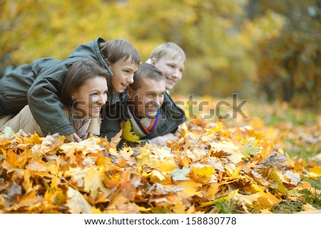 beautiful happy family for a walk in the park fall - stock photo