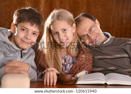beautiful happy family on a brown background - stock photo