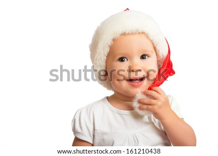 Beautiful happy funny baby in a Christmas hat  isolated on white background - stock photo
