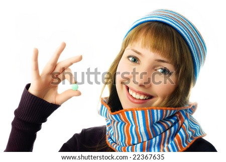 beautiful happy girl holding a tablet in her hand isolated against white background