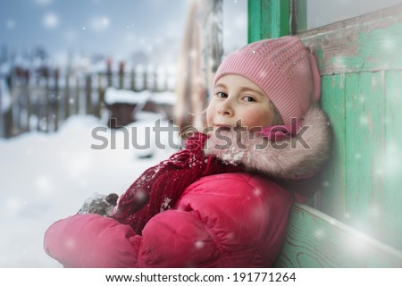 Beautiful happy girl in the red jacket in the winter. - stock photo