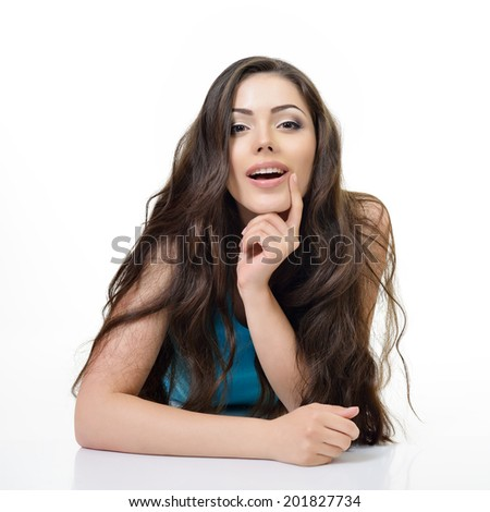 Beautiful happy girl lying and looking at camera. Isolated on white background - stock photo