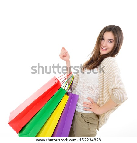 beautiful happy girl shopaholic with colored shopping bags, over white - stock photo