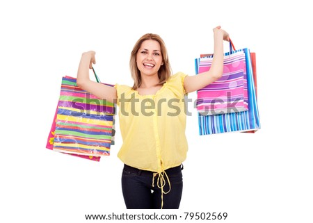 beautiful happy girl with color shopping bags in hands, isolated on white background