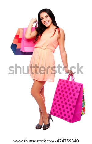 Beautiful happy girl with shopping bags on shoppingspree, consumer lifestyle concept.
