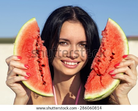 Beautiful happy girl with slice of ripe water-melon - stock photo