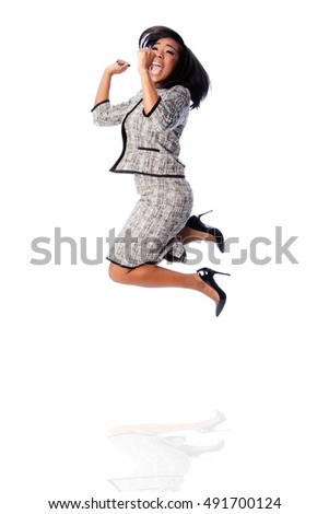 Beautiful happy jumping cheering business woman celebrating joyfully, on white.