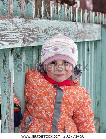 Beautiful happy kid in the winter outdoors. - stock photo