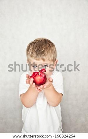 beautiful happy little boy with christmas ball - stock photo