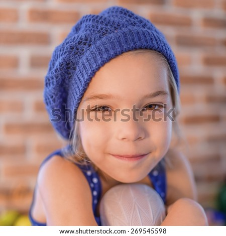 Beautiful happy little girl in blue beret smile. - stock photo