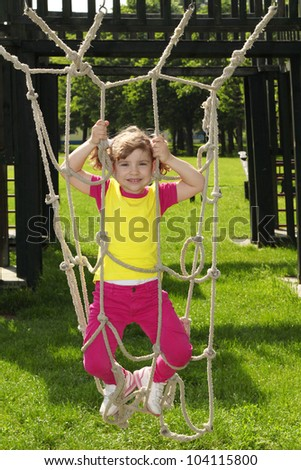 beautiful happy little girl on playground
