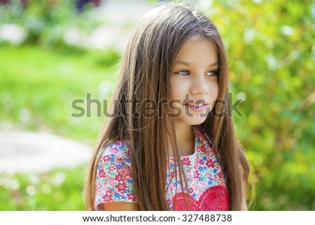 Beautiful Happy little girl outdoors