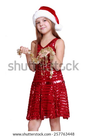 beautiful happy little girl with long blond hair in Santa hat holding christmas golden star isolated on white/Christmas portrait of a cute child in a Santa's hat - stock photo