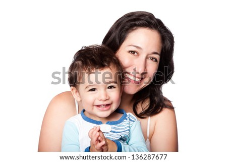 Beautiful happy mother and baby toddler son smiling together, isolated.