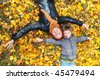 Beautiful happy mother and son in the park - stock photo