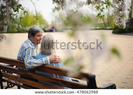 beautiful happy old people sitting in the spring park