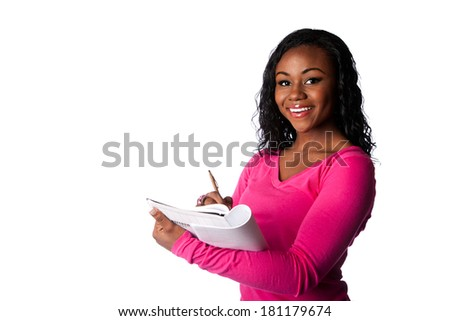 Beautiful happy smart college student smiling and writing in notebook taking notes, isolated. - stock photo