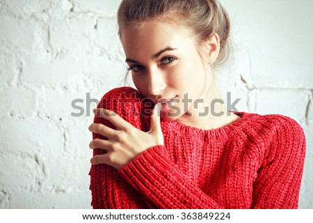 beautiful happy smiling blonde woman girl in warm red sweater. Glamour style portrait - stock photo