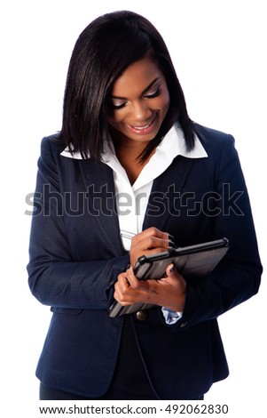 Beautiful happy smiling business woman writing on digital tablet taking notes, on white.