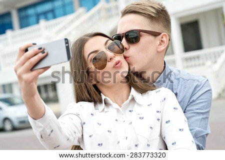Beautiful happy smiling couple in love having fun together end enjoy their love and romantic date. Close up portrait of loving couple. Couple making selfie. - stock photo