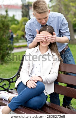 Beautiful happy smiling couple in love having fun together end enjoy their love and romantic date. Close up portrait of loving couple in park. - stock photo