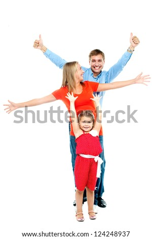 Beautiful happy smiling family of three people with young daughter, indoors