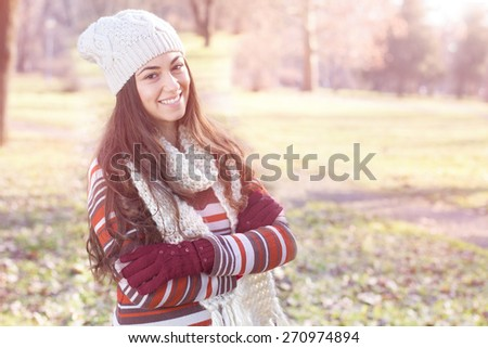 Beautiful Happy Smiling Girl winter autumn season outdoor portrait. Caucasian female carefree lifestyle .