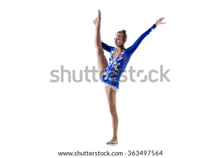 Beautiful happy smiling gymnast athlete teenage girl wearing dancer blue dress working out, dancing, posing, doing balance gymnastics exercise, standing splits, studio, white background, isolated - stock photo