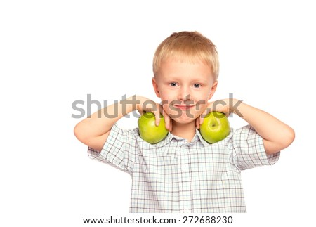 Beautiful happy smiling joyful child (little boy) eating healthy food (green apples)   isolated on white background - stock photo