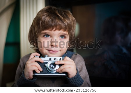 beautiful  happy smiling   little boy with a vintage camera have big eyes and long eyelashes - stock photo