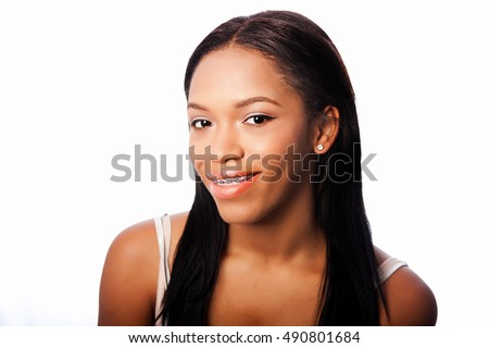 Beautiful happy smiling teenage girl with dental braces, on white.